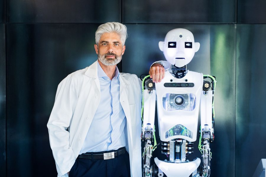 Scientist with humanoid robot